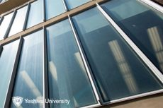 Front of Gottesman Library on Wilf Campus reflecting sunlight