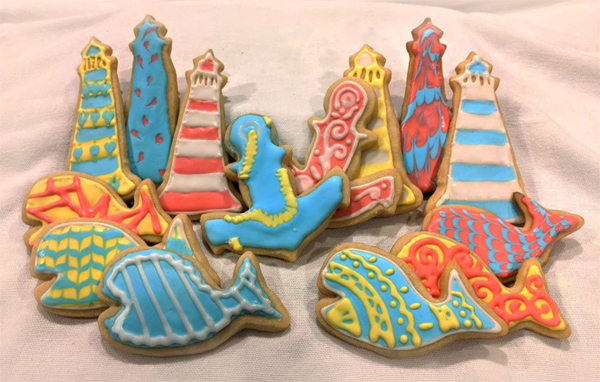 Collection of cookies decorated in sea themes and colors.