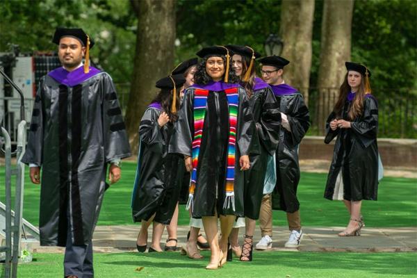Cardozo graduates march to the stage to receive their diplomas