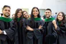 Picture of six Einstein grads in group shot