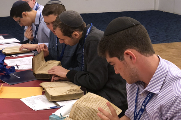 The high school students examine 18th- and 19th-century seforim (religious books).