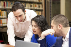 SGC Header image: three people looking at a computer