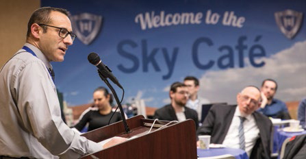 Dr. Daniel Rynhold at the podium