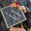 Woman holding mortarboard with phrase: Nevertheless, she persisted.